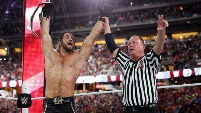 Referee-Raising-Rollins-Arm-For-Winning-The-Tittle